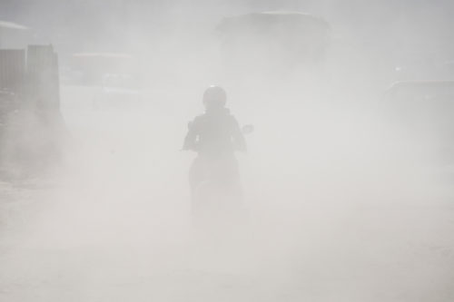 A motorcyclist rides through a polluted road in Lalitpur, Nepal. Photo: Skanda Gautam CC BY-NC-ND 4.0