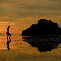 Carmela walks along the coast of Negros Occidental Photo credit PRRCFI