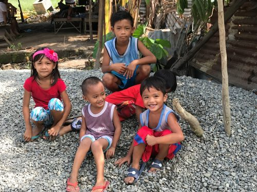 Children play in an area where Pure Earth cleaned up lead contamination in Pampanga, Philippines. Photo credit: Pure Earth